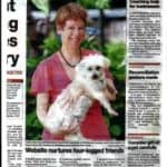 Cathy Beer holding Toby article in North Shore Times